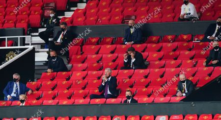 Manchester United Executive Vice-Chairman Ed Woodward looks on, centre left, along with former Chief Executive David Gill, drinking water, and former manager Sir Alex Ferguson, far left