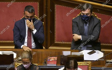 Italian Foreign Affairs Minister Luigi Di Maio (L) and Relations with European Affairs Minister Vincenzo Amendola (R), both wearing a face mask, listen as Italian Prime Minister Giuseppe Conte (not pictured) delivers a speech about an EU deal on a post-coronavirus Recovery Fund, at the Senate, in Rome, Italy, 22 July 2020. EU leaders have reached a deal on a post-coronavirus Recovery Fund during a five-day summit, the longest summit in the union's history.