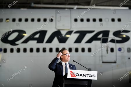 Qantas CEO Alan Joyce speaks in front of Qantas Airways flight QF7474 during an official farewell event for the Qantas 747 fleet at Sydney Airport in Sydney, New South Wales, Australia, 22 July 2020. The iconic aircraft type is being retired from the Qantas fleet after almost 50 years of service.