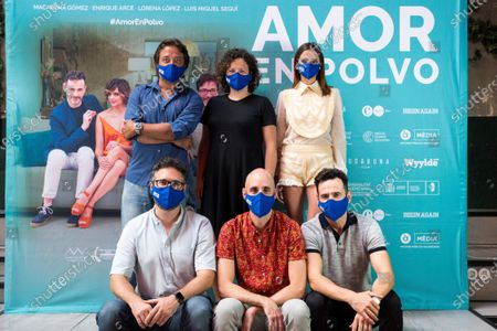 Spanish cast members (front, from-L) Spanish film directors Juanjo Moscardo and Suso Imbernon next to cast member Luis Miguel Segui and (rear, from-L) actor Enrique Arce, scriptwriter Maria Minguez and actress Macarena Gomez pose for the photographer during the presentation of the film 'Amor en Polvo' (Powdered Love) in Madrid, Spain, 22 July 2020. The movie, shot in 17 days, will open in Spanish cinemas on 24 July.