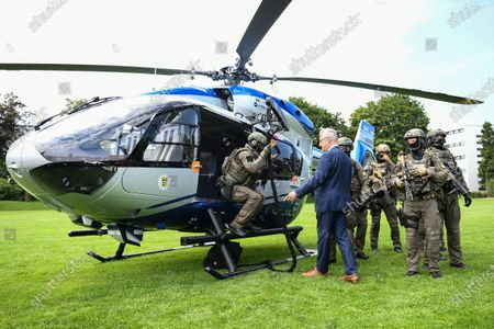 Bavaria's Interior Minister Joachim Herrmann poses for a picture with police special forces next to a H145 helicopter during a press conference at the police headquarters in Munich, Germany, 22 July 2020. Bavaria's police is purchasing eight new Airbus H145 helicopters offering increased payload capacity and overall performance compared to the EC135 model currently in service.