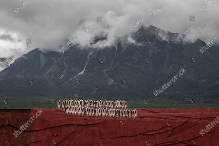 Members of the Naxi, Yi and Bai ethnic minorities perform a cultural show entitled Impression Lijiang with Jade Dragon Snow Mountain as a backdrop, in Lijiang, Yunnan province, China, 15 July 2020 (issued 22 July 2020). Directed by Chinese filmmaker Zhang Yimou, the production aims to present the traditions and the lifestyle of these minorities. Yunnan province is one of the most popular tourist destinations in China, known for its natural scenery, historical and cultural heritage. The tourism industry that was badly affected in China by the Covid-19 pandemic is slowly recovering with more tourists starting to travel around the country. In a survey conducted in May by Boston Consulting Group some 59 percent of the Chinese mainland respondents said they were worried about their finances and traveling.