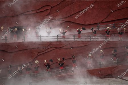 Stock Picture of Members of the Naxi, Yi and Bai ethnic minorities perform a cultural show entitled Impression Lijiang with Jade Dragon Snow Mountain as a backdrop, in Lijiang, Yunnan province, China, 15 July 2020 (issued 22 July 2020). Directed by Chinese filmmaker Zhang Yimou, the production aims to present the traditions and the lifestyle of these minorities. Yunnan province is one of the most popular tourist destinations in China, known for its natural scenery, historical and cultural heritage. The tourism industry that was badly affected in China by the Covid-19 pandemic is slowly recovering with more tourists starting to travel around the country. In a survey conducted in May by Boston Consulting Group some 59 percent of the Chinese mainland respondents said they were worried about their finances and traveling.