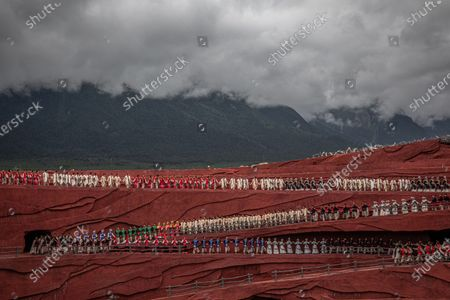Stock Photo of Members of the Naxi, Yi and Bai ethnic minorities perform a cultural show entitled Impression Lijiang with Jade Dragon Snow Mountain as a backdrop, in Lijiang, Yunnan province, China, 15 July 2020 (issued 22 July 2020). Directed by Chinese filmmaker Zhang Yimou, the production aims to present the traditions and the lifestyle of these minorities. Yunnan province is one of the most popular tourist destinations in China, known for its natural scenery, historical and cultural heritage. The tourism industry that was badly affected in China by the Covid-19 pandemic is slowly recovering with more tourists starting to travel around the country. In a survey conducted in May by Boston Consulting Group some 59 percent of the Chinese mainland respondents said they were worried about their finances and traveling.