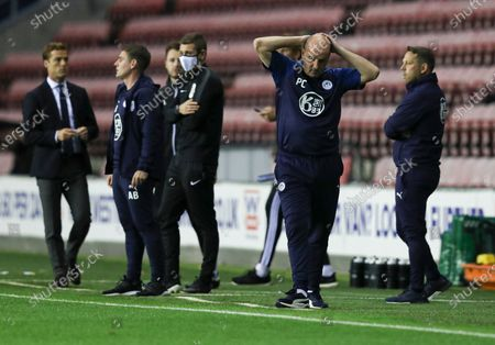 Paul Cook manager of Wigan Athletic looks dejected on the final whistle