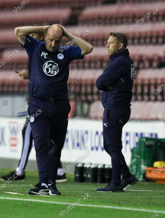 Stock Photo of Paul Cook manager of Wigan Athletic looks dejected on the final whistle