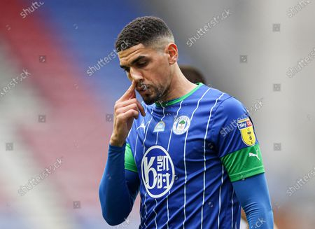 Leon Balogun of Wigan Athletic clears his nose