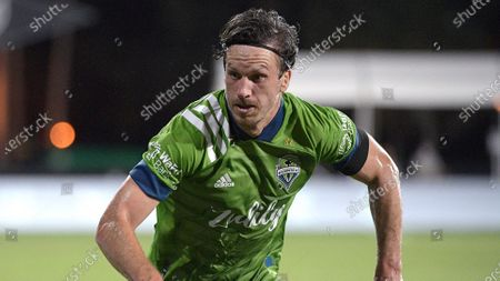 Seattle Sounders defender Gustav Svensson follows a play during the second half of an MLS soccer match against the Vancouver Whitecaps, in Kissimmee, Fla