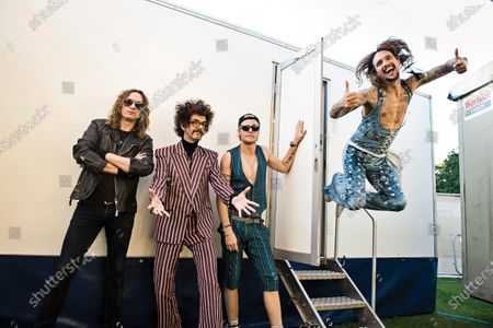 (L-R) Dan Hawkins, Frankie Poullain, Rufus Taylor and Justin Hawkins of British rock group The Darkness, photographed at Chantry Park in Ipswich on August 23, 2019.