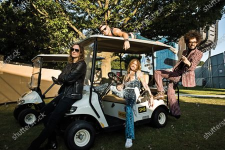 (L-R) Dan Hawkins, Rufus Taylor, Justin Hawkins and Frankie Poullain of British rock group The Darkness, photographed at Chantry Park in Ipswich on August 23, 2019