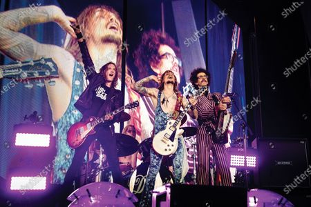 (L-R) Dan Hawkins, Rufus Taylor, Justin Hawkins and Frankie Poullain of British rock group The Darkness performing live on stage at Chantry Park in Ipswich on August 23, 2019