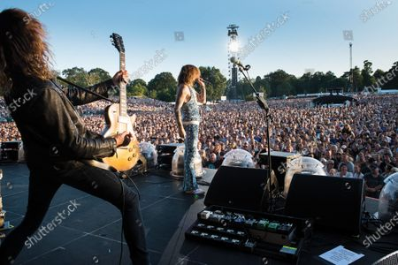 Guitarist Dan Hawkins (L) and vocalist Justin Hawkins of British rock group The Darkness, photographed at Chantry Park in Ipswich on August 23, 2019