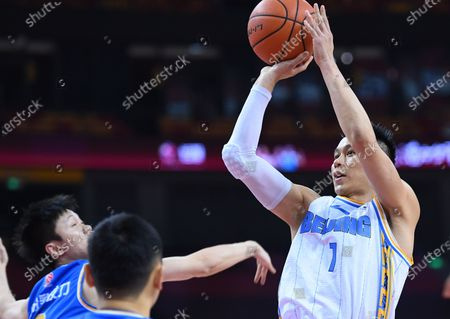 Stock Picture of Jeremy Lin (R) of Beijing Ducks shoots during a match between Beijing Ducks and Fujian Sturgeons at the 2019-2020 Chinese Basketball Association (CBA) league in Qingdao, east China's Shandong Province, July 22, 2020.