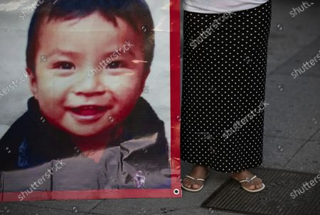 Juana Perez, whose 2 1/2 year-old son Dylan is missing, holds a poster of him outside of the presidential palace where she seeks help from President Manuel Andres Lopez Obrador to find him, in Mexico City, . The search for Perez's boy who was led away from a market in southern Mexico's Chiapas state three weeks ago led police to a horrifying discovery: 23 abducted children being kept at a house and forced to sell trinkets in the street. Pérez said officials told her that her son had not yet been found