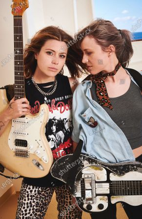 MEDITERRANEAN SEA - AUGUST 18: Portrait of American musicians Rebecca Lovell (L) and Megan Lovell, guitarists with rock group Larkin Poe, photographed onboard the Norwegian Pearl cruise ship during the Keeping the Blues Alive at Sea event on August 18, 2019.