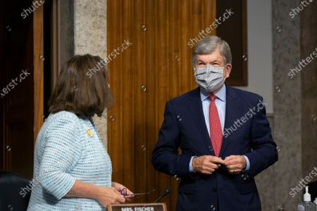 United States Senator Roy Blunt (Republican of Missouri), right, speaks to United States Senator Deb Fischer (Republican of Nebraska) during a Senate Committee on Commerce, Science, and Transportation business meeting at the U.S. Capitol in Washington D.C., U.S..