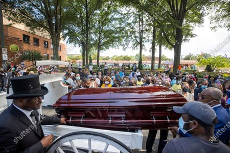 A horse-drawn hearse brings the casket of the late Civil Rights leader Reverend C.T. Vivian to the tomb of Martin Luther King Jr and his wife Coretta Scott King along historic Auburn Avenue in Atlanta, Georgia, USA, 22 July 2020. Vivian, a close friend and lieutenant of Martin Luther King Jr, died 17 July 2020 at age 95. Vivian helped to organize lunch counter sit-ins, boycotts, marches, including the Freedom Rides, throughout the South in the 1960s. He died on the same day as late US Representative John Lewis.