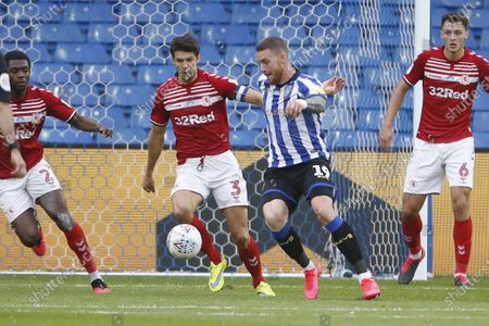 Stock Picture of Connor Wickham of Sheffield Wednesday and George Friend of Middlesbrough  during the EFL Sky Bet Championship match between Sheffield Wednesday and Middlesbrough at Hillsborough, Sheffield