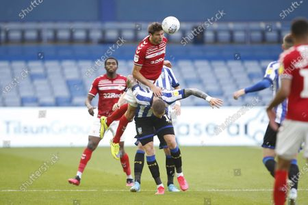 George Friend of Middlesbrough wins a header against Connor Wickham of Sheffield Wednesday  during the EFL Sky Bet Championship match between Sheffield Wednesday and Middlesbrough at Hillsborough, Sheffield
