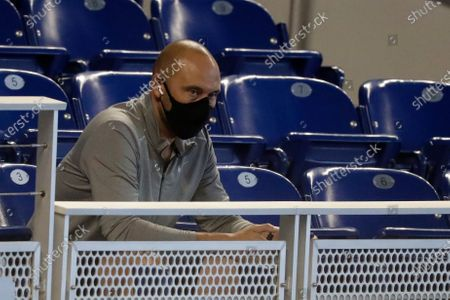 Miami Marlins CEO Derek Jeter watches the baseball team's practice in Miami. Jeter, who knows all about games in an empty ballpark, says success this season will require adapting to the absence of fans