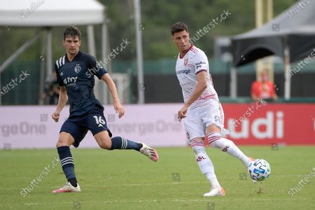 Real Salt Lake midfielder Damir Kreilach (8) passes the ball in front of Sporting Kansas City midfielder Graham Smith (16) during the first half of an MLS soccer match, in Kissimmee, Fla