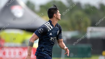 Sporting Kansas City forward Alan Pulido follows a play during the first half of an MLS soccer match against Real Salt Lake, in Kissimmee, Fla