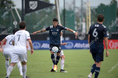 Sporting Kansas City forward Alan Pulido (9) controls a ball during the second half of an MLS soccer match against Real Salt Lake, in Kissimmee, Fla