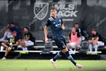 Sporting Kansas City midfielder Graham Smith follows a play during the second half of an MLS soccer match against the Real Salt Lake, in Kissimmee, Fla