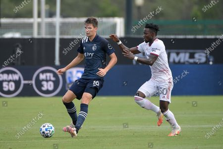 Sporting Kansas City midfielder Graham Smith (16) controls a ball in front of Real Salt Lake forward Sam Johnson (50) during the first half of an MLS soccer match, in Kissimmee, Fla