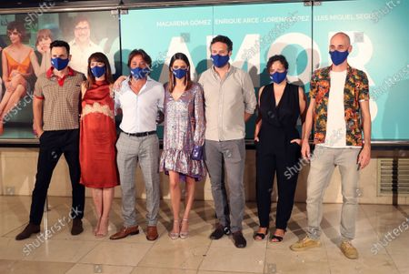 Spanish film directors Suso Imbernon (R) and Juanjo Moscardo Rius (3-R), scriptwriter Maria Minguez (2-R), and cast members Luis Miguel Segui (L), Lorena Lopez (2-L), Enrique Arce (3-L), and Macarena Gomez (4-L) wear face masks as they pose for the photographerduring the presentation of their film 'Amor en Polvo' (Powdered Love) in Madrid, Spain, 22 July 2020. The movie, shot in 17 days, will open in Spanish cinemas on 24 July 2020.