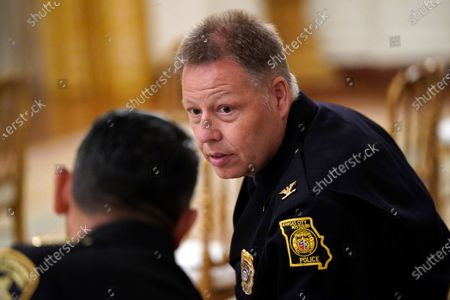 """Kansas City police Chief Rick Smith, right, speaks with Bernalillo County Sheriff Manuel Gonzales before an event on """"Operation Legend: Combatting Violent Crime in American Cities,"""" in the East Room of the White House, in Washington"""
