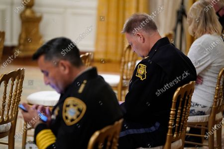 """Bernalillo County Sheriff Manuel Gonzales, left, and Kansas City police Chief Rick Smith, wait for an event on """"Operation Legend: Combatting Violent Crime in American Cities,"""" to begin in the East Room of the White House, in Washington"""