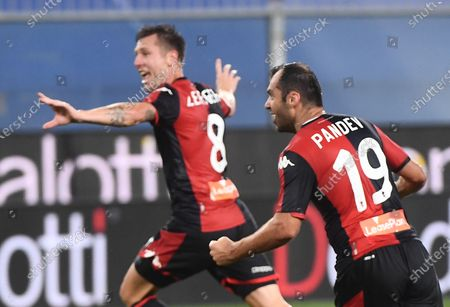 Stock Image of Genoa's Lukas Lerager (L) jubilates with his teammate after scoring during the Italian Serie A soccer match between UC Sampdoria vs Genoa CFC at the Luigi Ferraris stadium in Genoa, Italy 22 July 2020.