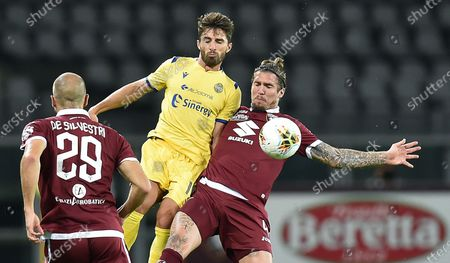 Torino's Lyanco (R) and Hellas Verona's Fabio Borini in action during the italian Serie A soccer match Torino FC vs Hellas Verona FC at the Olimpico Grande Torino stadium in Turin, Italy, 22 July 2020.
