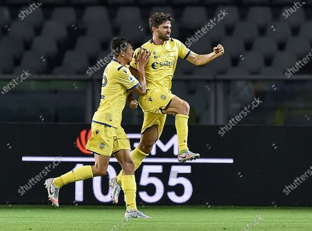 Stock Image of Hellas Verona's Fabio Borini (R) jubilates after scoring  during the italian Serie A soccer match Torino FC vs Hellas Verona FC at the Olimpico Grande Torino stadium in Turin, Italy, 22 July 2020.