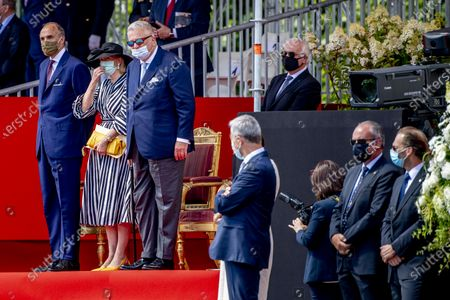 Prince Laurent of Belgium, Prince Lorenz of Belgium and Princess Astrid of Belgium pictured wearing a mouth mask during the official celebration on the occasion of Today's Belgian National Day, at the Paleizenplein/ Place des Palais.