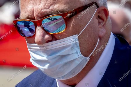 Stock Image of Prince Laurent with mouth mask mouth cap attending the Belgian national holiday 2020.