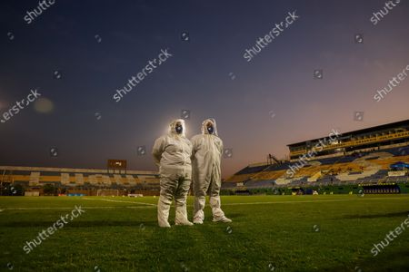 Health workers stand in the pitch prior the Apertura Tournament soccer match between Sportivo Luqueno and Olimpia at Feliciano Caceres stadium in Luque, Paraguay, 22 July 2020. Paraguayan first division resumed on 21 July after a 135-day stop, due the coronavirus pandemic.