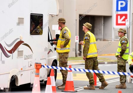 Defence personnel at a checkpoint on the Queensland-New South Wales border in Coolangatta, Queensland,  Australia, 23 July 2020. The barrier was built in a police push to stop illegal border crossings from New South Wales (NSW). Queensland Premier Annastacia Palaszczuk said the state government is considering declaring more NSW postcodes hotspots.