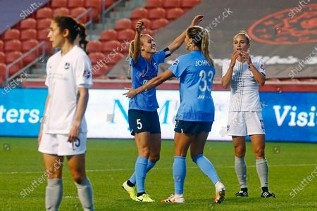 Chicago Red Stars' Rachel Hill (5) celebrates with teammate Katie Johnson (33) after scoring against the Sky Blue during the first half of an NWSL Challenge Cup soccer semifinal match, in Sandy, Utah