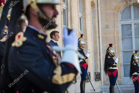 French President Emmanuel Macron (C) looks on President of Cyprus Nikos Anastasiades (not seen) as he leaves after their meeting at the Elysee Palace in Paris, France, 23 July 2020.