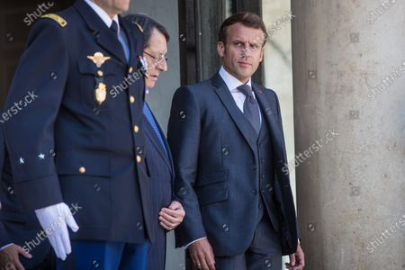 French President Emmanuel Macron (R) and President of Cyprus Nikos Anastasiades (L) after their meeting at the Elysee Palace in Paris, France, 23 July 2020.
