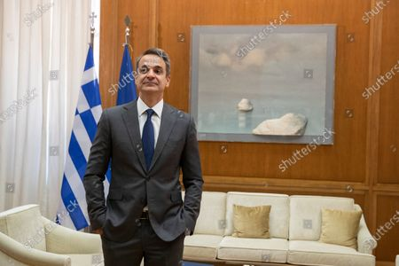 Greek Prime Minister Kyriakos Mitsotakis, waits the arrival of Syriza party leader Alexis Tsipras, before their meeting in Athens,, for talks expected to focus on developments in the East Mediterranean. Mitsotakis is meeting leaders of Greek opposition parties to discuss details of a European Union as well as an escalating dispute with neighbor Turkey over seabed mineral rights in the region