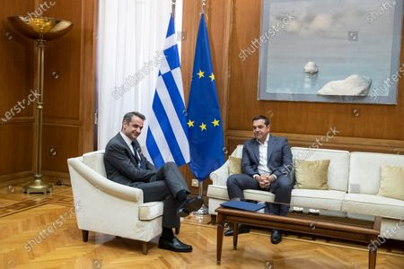 Greek Prime Minister Kyriakos Mitsotakis, left, meets with Syriza party leader Alexis Tsipras, in Athens,, for talks expected to focus on developments in the East Mediterranean. Mitsotakis is meeting leaders of Greek opposition parties to discuss details of a European Union as well as an escalating dispute with neighbor Turkey over seabed mineral rights in the region