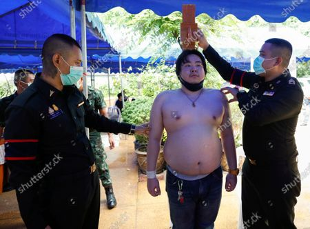 Thai army personnels take measures from a man for a physical check during military conscription in Bangkok, Thailand, 23 July 2020. The Royal Thai Armed Forces launched their annual military conscription draft day, searching for healthy men of fighting age from 21 years old, while transgender women who have a body not consistent with their birth sex and have undergone breast augmentation surgery and full gender reassignment operations are exempted from military service. Approximately 100,000 Thai men are drafted annually.