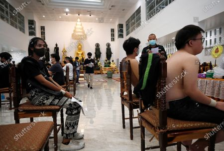 Thai transgender Aticha Choimsri (L) waits for register with other men during military conscription in Bangkok, Thailand, 23 July 2020. The Royal Thai Armed Forces launched their annual military conscription draft day, searching for healthy men of fighting age from 21 years old, while transgender women who have a body not consistent with their birth sex and have undergone breast augmentation surgery and full gender reassignment operations are exempted from military service. Approximately 100,000 Thai men are drafted annually.