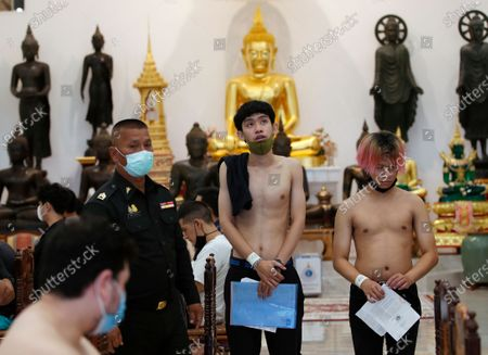 Thai men line up for basic health checks during military conscription in Bangkok, Thailand, 23 July 2020. The Royal Thai Armed Forces launched their annual military conscription draft day, searching for healthy men of fighting age from 21 years old, while transgender women who have a body not consistent with their birth sex and have undergone breast augmentation surgery and full gender reassignment operations are exempted from military service. Approximately 100,000 Thai men are drafted annually.
