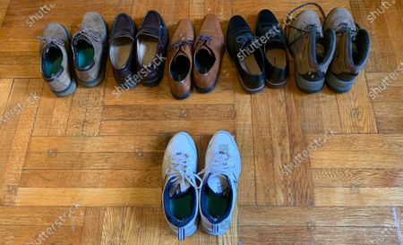 Stock Picture of Associated Press journalist Dave Clark displays the six pairs of shoes he owns in his apartment in Manhattan's Washington Heights neighborhood, in New York, with the one pair he's worn since lockdown, caused by the coronavirus pandemic, began