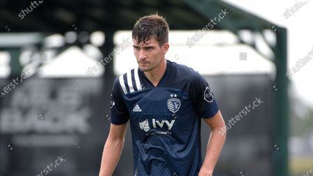 Sporting Kansas City midfielder Graham Smith (16) sets up for a play during the second half of an MLS soccer match against the Real Salt Lake, in Kissimmee, Fla