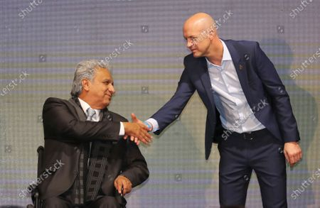 Ecuador's President Lenin Moreno, left, welcomes Jordi Cruyff as Ecuador's new national soccer coach in Quito, Ecuador. Cruyff resigned from the post on without having led a single game or even a training session, according to the Ecuador's national soccer federation